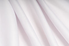 White cloth with pink shade in the folds Royalty Free Stock Photos