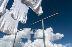 White clothes getting dry on a wire royalty free stock images
