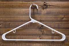 White clothes hanger Stock Images