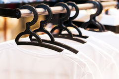 White clothes hanging on hangers Stock Images