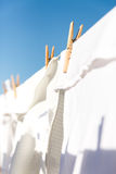 White clothes hung out to dry in the bright warm sun Stock Photo