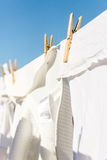 White clothes hung out to dry in the bright warm sun Royalty Free Stock Photos