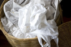 White clothes in laundry basket Royalty Free Stock Photos