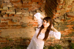 White clothes on a young girl on brick wall background Royalty Free Stock Photos