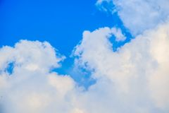 White cloud against blue sky Royalty Free Stock Image