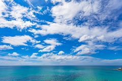 White cloud  in blue sky above the ocean stock photography