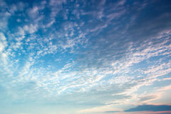 White cloud, blue sky, sun rays Royalty Free Stock Images