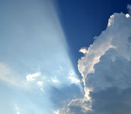 White cloud in the blue sky. Blue sky with white clouds background divided by sunrays Stock Photography