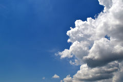 White cloud in the blue sky. Blue sky with white clouds on one side Stock Photo