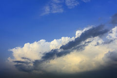 White cloud on blue sky with dark cloud in front Stock Photo