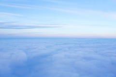 White cloud on blue sky. See through the plane window Stock Photo