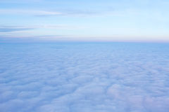 White cloud on blue sky. See through the plane window Royalty Free Stock Photo