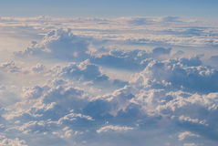 White cloud in blue sky. On top Stock Images