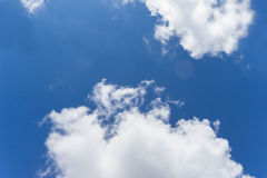 White cloud in the blue sky. View from bottom up Royalty Free Stock Images