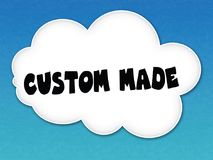 White cloud with CUSTOM MADE message on blue sky background. Illustration Royalty Free Stock Images