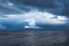 White cloud and dark sea. Royalty Free Stock Images