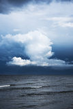 White cloud and dark sea. Royalty Free Stock Photography
