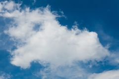White cloud on deep blue sky background, ecology.  royalty free stock image
