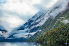 White cloud and high mountain in milford sound fiord land nation Royalty Free Stock Photo
