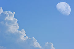 White cloud with moon on blue sky background Stock Photos