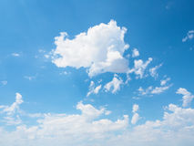 White cloud in natural form as per imagination with blue sky bac. White cloud in natural form or as per imagination with blue sky background on sunny day Royalty Free Stock Image