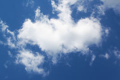 White cloud over blue sky Stock Images