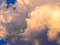 White cloud in the sky. One White cloud - cumulus-n in the sky, with speck of blue sky visible on right hand side only. Good for background or screensaver royalty free stock image