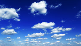 White clouds. On background blue sky Stock Images