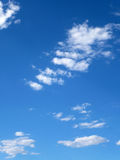White Clouds. On a clear sky in a sunny day Royalty Free Stock Photography