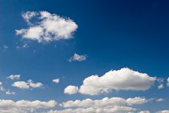 White Clouds. With Deep Blue Sky stock photography
