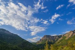 White clouds above blue mountains Royalty Free Stock Images