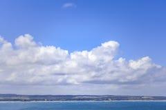 White clouds above ocean coastline in Australia. Stock Image