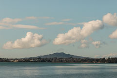 White clouds above Rangitoto Island Stock Photography