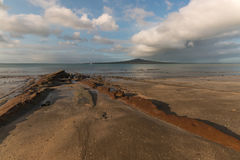 White clouds above Rangitoto Island Royalty Free Stock Image