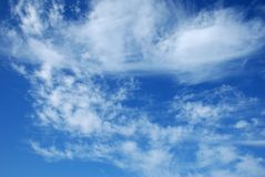 White clouds against the blue sky. Beautiful, white, fluffy clouds against the blue sky before sunset Stock Images