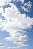 White clouds against a blue sky Stock Image