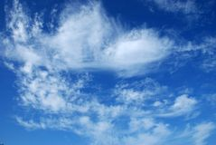 White clouds against the blue sky 3. Beautiful, white, fluffy clouds against the blue sky before sunset Stock Photo