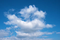White clouds against blue sky background Stock Image