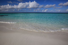 White clouds against blue sky, clear water and white sand Stock Photo