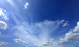 White clouds against blue sky. Stock Photos