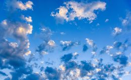 Clouds and heavens. White clouds against the blue sky Stock Photos