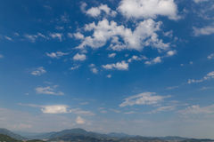 White clouds against a blue sky. horizon. White clouds against a blue sky. horizon Royalty Free Stock Photos