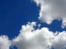 White Clouds against a Blue Sky Stock Photography