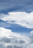 White clouds against the blue sky in the summer Royalty Free Stock Photography