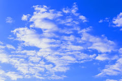 White clouds against a bright blue sky Stock Photo
