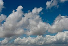 White clouds and airplanes in the clouds stock images