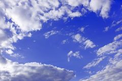 White clouds around blue sky Stock Photos
