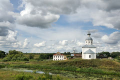 White Clouds Around the Church of Elijah the Prophet - Suzdal Cityscapes. Amazing view from earthen rampart of Suzdal Kremlin on the beautiful skies with white Royalty Free Stock Photography