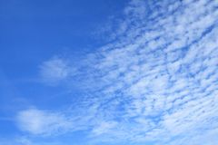 White clouds in azure sky. As background stock image