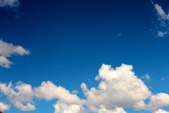 White clouds on background of dark blue sky Stock Photos